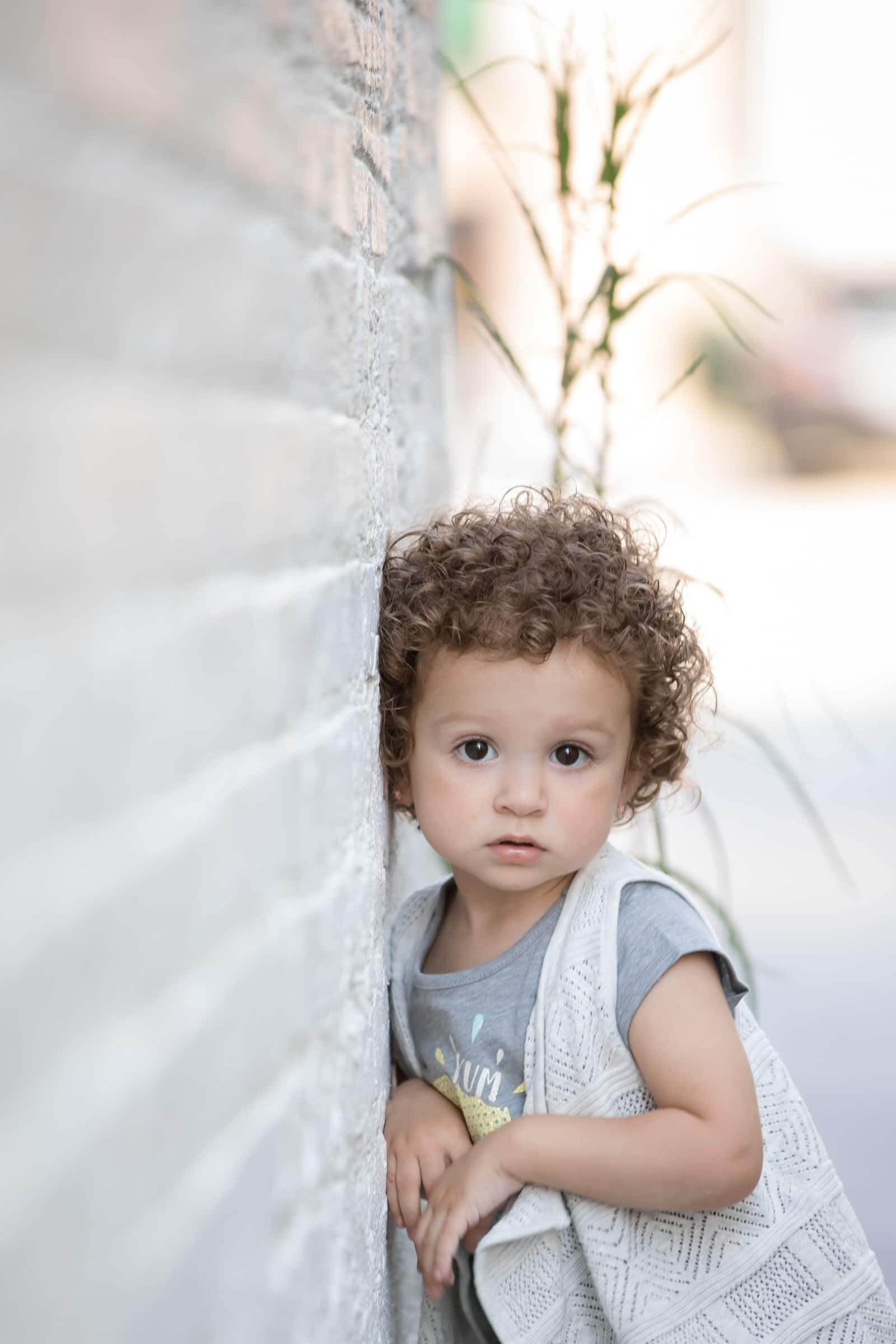model portfolio picture of toddler girl with curly hair