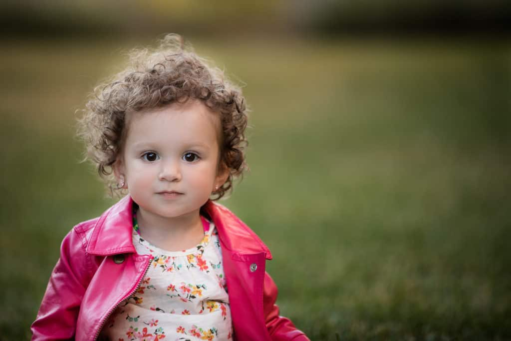 adorable toddler girl with pink jacket