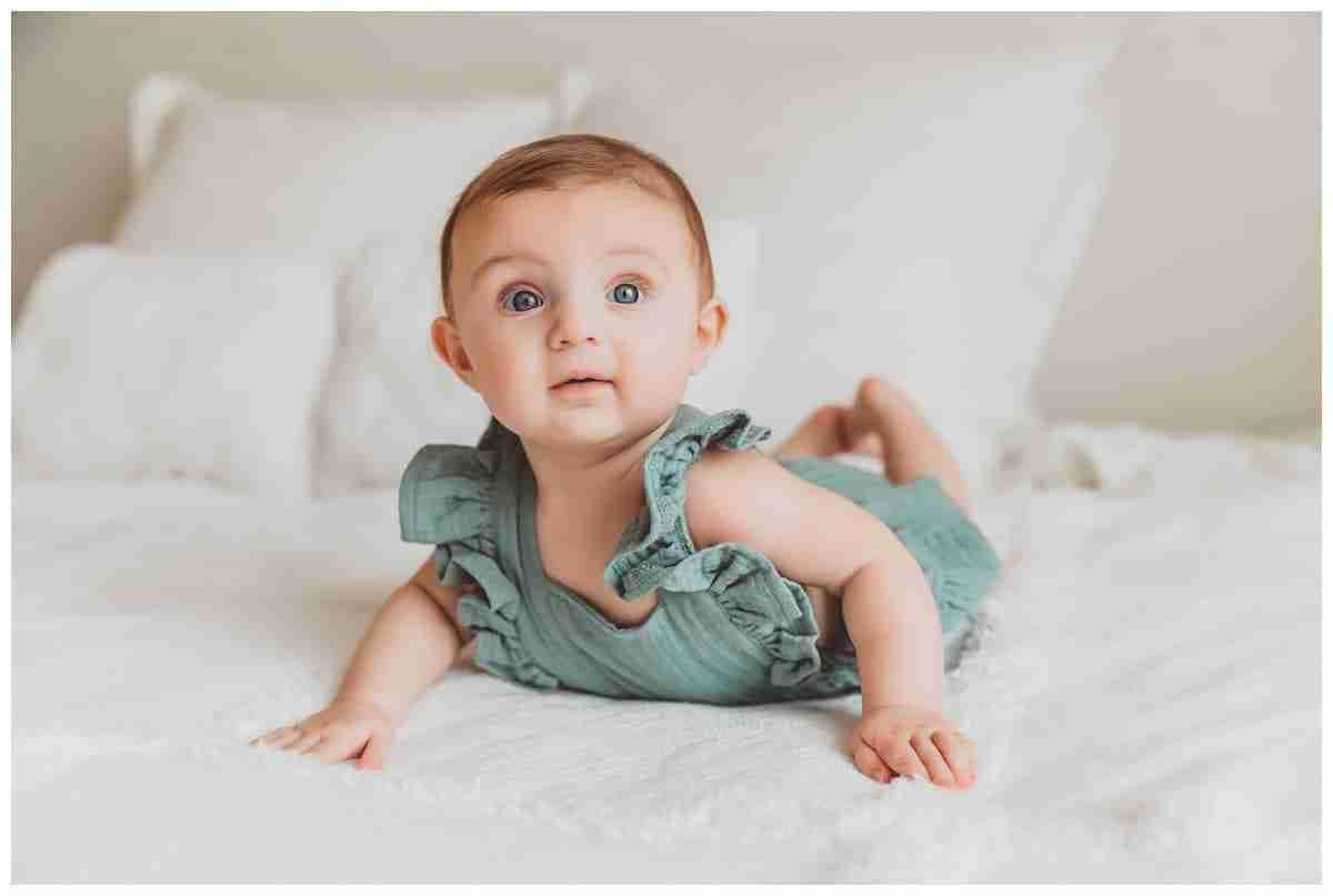 baby girl 5 months old teal jumper blue eyes